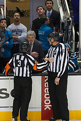 Jan 17, 2012; San Jose, CA, USA; San Jose Sharks head coach Todd McLellan argues with NHL referee Mike Leggo (3) after a goal was disallowed during the overtime period against the Calgary Flames at HP Pavilion. San Jose defeated Calgary 2-1 in shootouts. Mandatory Credit: Jason O. Watson-US PRESSWIRE