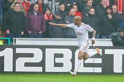 SWANSEA, WALES - Sunday, May 1, 2016: Swansea City's Andre Ayew celebrates scoring the first goal against Liverpool during the Premier League match at the Liberty Stadium. (Pic by David Rawcliffe/Propaganda)