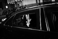 Fomer Prime Minister of Italy Silvio Berlusconi waves from the backseat of a car as he leaves the inauguration of the new headquarters of Forza Italia, the center-right party he leads, in Rome, Italy, on September 19th 2013.<br /> <br /> The party Forza Italia, consisting of the former People of Freedom (PdL), is a revival of a party with the same name, active from 1994 to 2009, when it was merged with National Alliance (AN) and several minor parties to form the Popolo della Libertà (PdL). As in 1994, the party's leader is Silvio Berlusconi, four-times Prime Minister of Italy.