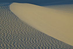 A sand dune's two appearances, smooth and wavy, are easily visible in White Sands National Monument, New Mexico.