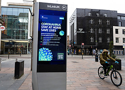 Glasgow, Scotland, UK. 26 March, 2020. Views from city centre in Glasgow on Thursday during the third day of the Government sanctioned Covid-19 lockdown. The city is largely deserted. Only food and convenience stores open. Pictured; Video screen on Buchanan Street giving medical advice about Coronavirus. Iain Masterton/Alamy Live News