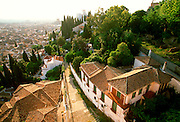 SPAIN, ANDALUSIA, GRANADA homes or Carmens built on hillside below the Torres Bermejas with splendid views across city