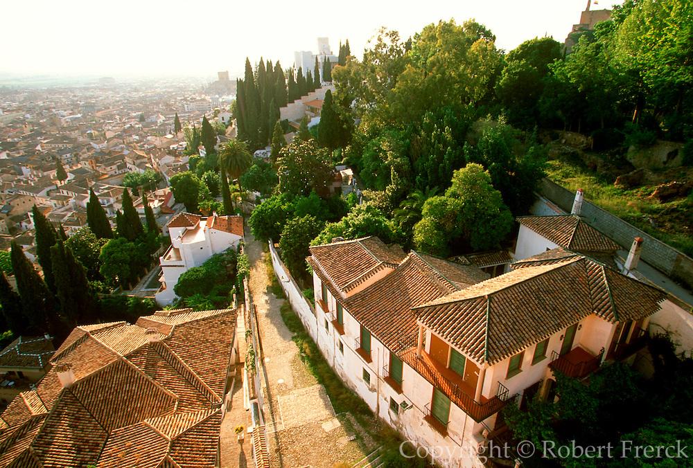 SPAIN, ANDALUSIA, GRANADA homes or Carmens built on hillside below the Torres Bermejas with splendid views across city