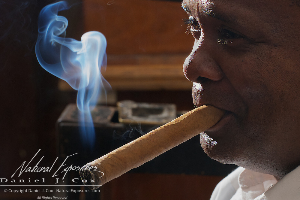 A cigar craftsman making cigars at the Cuban National Hotel, Havana, Cuba.