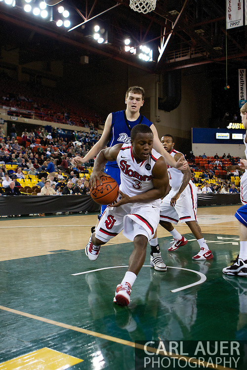 November 26th, 2010:  Anchorage, Alaska - St. John's senior guard Malik Boothe (3) grabs a rebound baseline in the Red Storm's semi final game of the Great Alaska Shootout against the Drake Bulldogs.  The Red Storm defense held Drake to a tournament low score as St. Johns advanced to the final game 82-39.