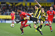 Oldham Athletic forward Aaron Amadi-Holloway battles with Burton Albion defender Tom Flanagan during the Sky Bet League 1 match between Burton Albion and Oldham Athletic at the Pirelli Stadium, Burton upon Trent, England on 26 March 2016. Photo by Jon Hobley.