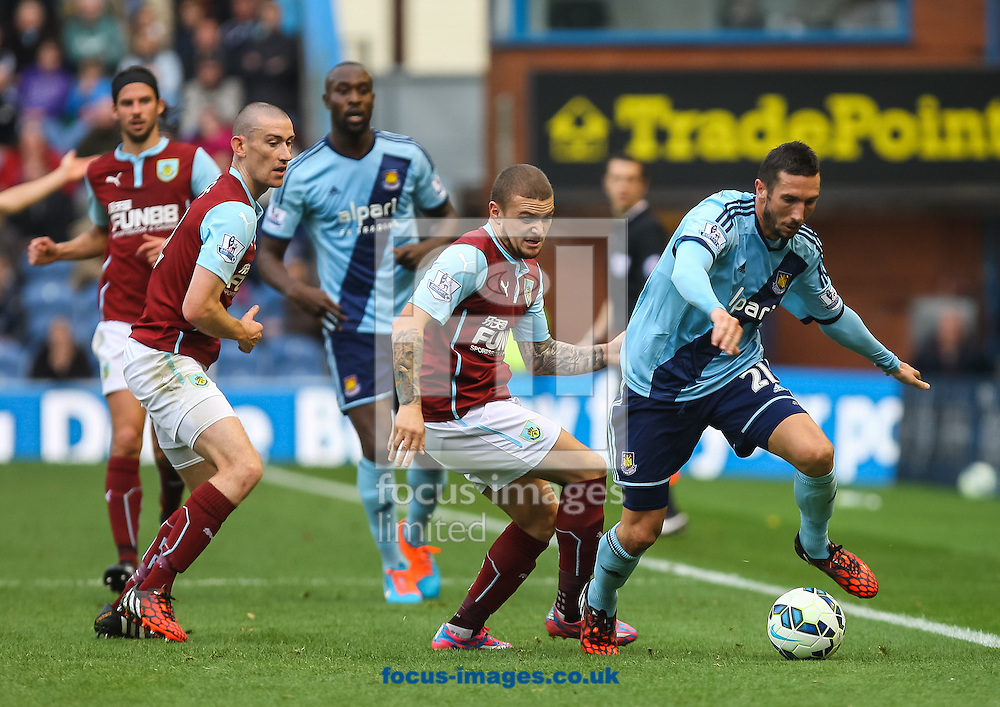 Morgan Amalfitano of West Ham United takes the ball past Kieran Trippier of Burnley during the Barclays Premier League match at Turf Moor, Burnley<br /> Picture by Daniel Chesterton/Focus Images Ltd +44 7966 018899<br /> 18/10/2014
