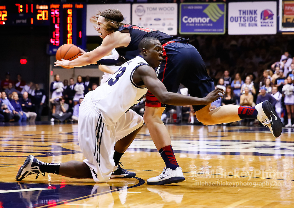 INDIANAPOLIS, IN - JANUARY 19: Kelly Olynyk #13 of the Gonzaga Bulldogs tries to pass off the ball as Khyle Marshall #23 of the Butler Bulldogs grabs him at Hinkle Fieldhouse on January 19, 2013 in Indianapolis, Indiana. (Photo by Michael Hickey/Getty Images) *** Local Caption *** Kelly Olynyk; Khyle Marshall