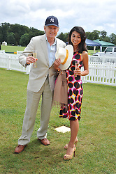 JOHN STEPHEN and MIE MOCHIDA at the 2011 Veuve Clicquot Gold Cup Final at Cowdray Park, Midhurst, West Sussex on 17th July 2011.