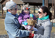 EDITORS NOTE: CAPTION CORRECTION: CORRECTS LAUREN MURTA: Justin Murta, Luciana Murta, 1.5 years old, and Lauren Murta, all of New Britain, share a laugh after having there own Easter Egg hunt Saturday March 28, 2015 at North Branch Park in New Britain Township, Pennsylvania. The New Britain East Egg Hunt was cancelled due to field conditions. . (Photo by William Thomas Cain/Cain Images)
