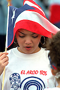Girl age 10 Puerto Rican flag on head Cinco de Mayo festival.  St Paul Minnesota USA
