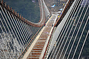 ZHENGZHOU, CHINA - JANUARY 26: (CHINA OUT) <br /> <br /> General view of a suspension bridge, about 300 metres above ground, at The Grand Canyon of Zhangjiajie on January 27, 2016 in Zhangjiajie, Hunan Province of China. The glass-bottomed bridge, 430 meters in length and 6 meters in width, is expected to open in May this year.<br /> ©Exclusivepix Media