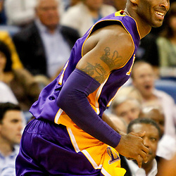 Dec 5, 2012; New Orleans, LA, USA; Los Angeles Lakers shooting guard Kobe Bryant (24) smiles after hitting a shot against the New Orleans Hornets during the fourth quarter of a game at the New Orleans Arena. The Lakers defeated the Hornets 103-87.  Mandatory Credit: Derick E. Hingle-USA TODAY Sports