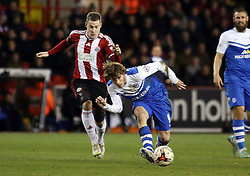 Peterborough United's Luke James in action with Sheffield United's Paul Coutts - Photo mandatory by-line: Joe Dent/JMP - Mobile: 07966 386802 - 03/03/2015 - SPORT - Football - Sheffield - Bramall Lane - Sheffield United v Peterborough United - Sky Bet League One