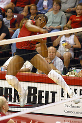 Stanford's Ogonna NNamani rides air after slamming the ball. The game and set was won by Stanford.  The match up took place at ISU's Redbird Arena in Normal Illinois on September 11, 2002.  The crowd was over 5600 and took the record for fans attending a volleyball game at Redbird, the MVC's record for number of fans watching a conference team and was the largest audience in the continental US thus far in the 2002 season<br />