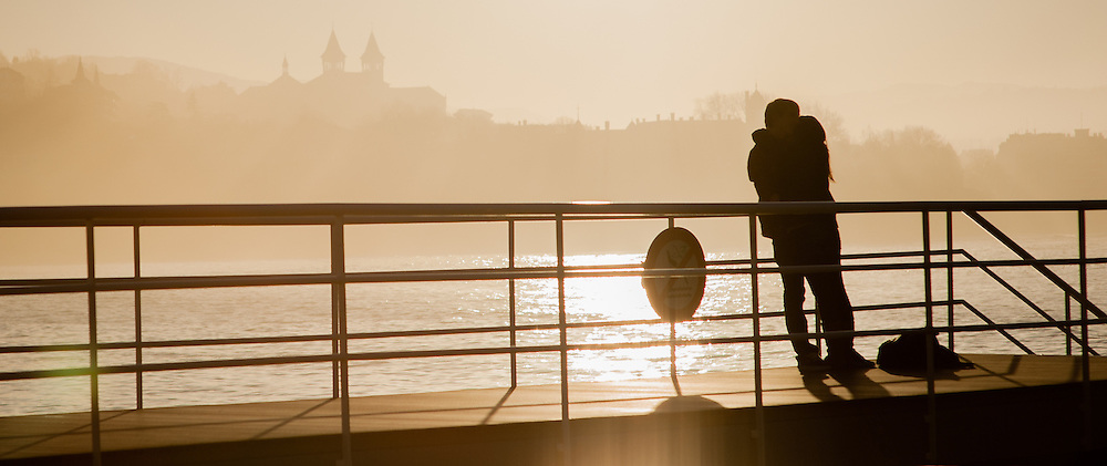 Young couple kissing on La Concha beach pier in San Sebastian (Spain)