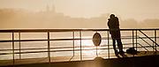 Young couple kissing on La Concha beach pier in San Sebastian (Spain)