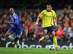 Daniel Alves of Barcelona goes past Nicolas Anelka of Chelsea during the UEFA Champions League Semi Final Second Leg match between Chelsea and Barcelona at Stamford Bridge on May 6, 2009 in London, England.