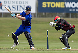 Otago Volts' Jimmy Neesham, left, batting as Canterbury's Tom Latham keeps wicket in the Ford Trophy one-day domestic cricket match at the University of Otago Oval, Dunedin, New Zealand, Saturday, January 27, 2018. Credit:SNPA / Adam Binns ** NO ARCHIVING**