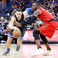 25 February 2017: Orlando Magic forward Aaron Gordon (00) drives past Atlanta Hawks forward Paul Millsap (4) during the Orlando Magic 105-86 victory over the Atlanta Hawks, at the Amway Center, Orlando, Florida, USA.