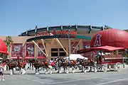 ANAHEIM - APRIL 10:  The Clydesdales make an appearance pulling a beer truck to the main outside entrance to the stadium prior to the Los Angeles Angels of Anaheim game between the Toronto Blue Jays at Angel Stadium in Anaheim, California on Sunday April 10, 2011. The Angels won the game 3-1. (Photo by Paul Spinelli/MLB Photos via Getty Images)