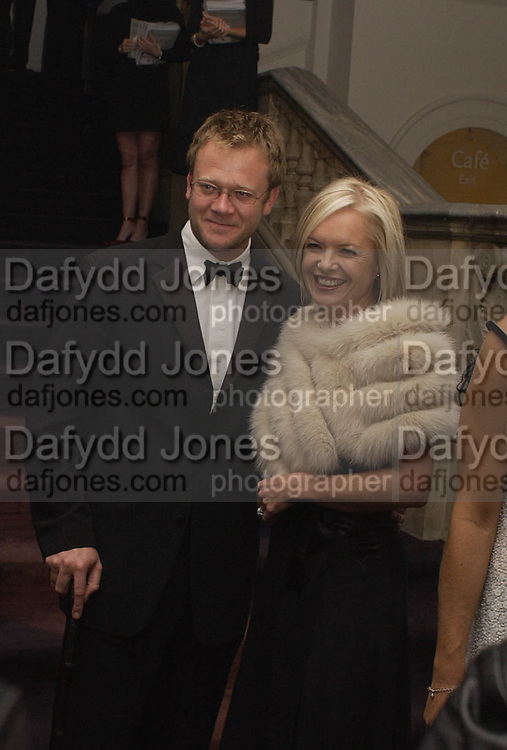 Mariella Frostrop and her husband, Giorgio Armani, ' A retrospective' sponsored by Mercedes, Royal Academy, 14 October 2003. © Copyright Photograph by Dafydd Jones 66 Stockwell Park Rd. London SW9 0DA Tel 020 7733 0108 www.dafjones.com