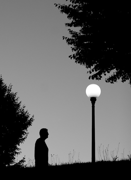 "Black and white photography.Man walking at night in Lucca Italy by Karl R Lilliendahl photographer. This photo is available as open edition and limited edition giclee print in four sizes. Click on ""Get Print"" to see more details."