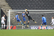 AFC Wimbledon goalkeeper James Shea (1) collects the cross during the EFL Sky Bet League 1 match between Milton Keynes Dons and AFC Wimbledon at Stadium MK, Milton Keynes, England on 10 December 2016. Photo by Stuart Butcher.