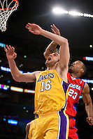 15 January 2010: Forward Pau Gasol of the Los Angeles Lakers reacts after shooting the ball while being guarded by Marcus Camby of the Los Angeles Clippers during the first half of the Lakers 126-86 victory over the Clippers at the STAPLES Center in Los Angeles, CA.