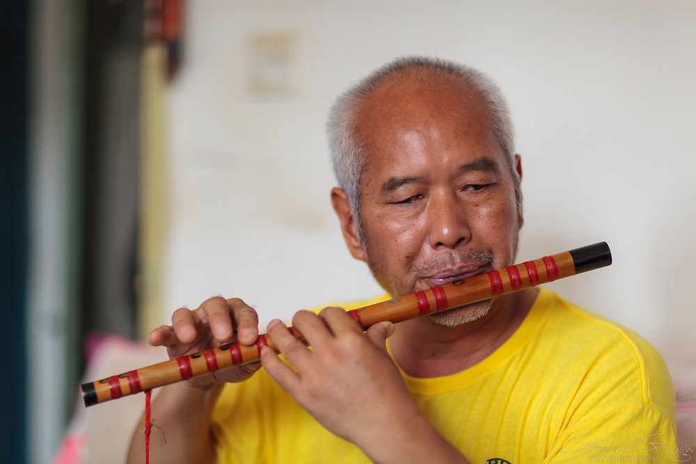 "Duan is described as a ""local legend"" by friends and neighbours. He became blind at the age of 40 years after suffering glaucoma. He said ""I felt bad because I could not see. I felt troubled because I was unable to do simple tasks"". As a result of various therapeutic services, Duan now walks with a cane and has a cleaning job at a local college, where his daughter works as a teacher. He has learned to play the flute, the cucurbit and Chinese cello. He says, ""I am so happy because I've started working and my family is very happy for me. I encourage people who learn from the miracle that has fallen over me""."