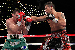 Mar 17; New York, NY, USA; Sergio Martinez (black/red trunks) and Matthew Macklin (green trunks) trade punches during their 12 round World Middleweight championship bout at the Theater at Madison Square Garden. Martinez won via 11th round TKO.