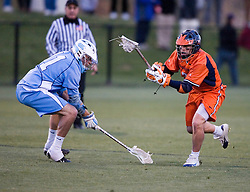 Virginia Cavaliers D Ricky Smith (3) battles with North Carolina Tar Heels David Ryan (11).  The Virginia Cavaliers Men's Lacrosse Team defeated the North Carolina Tar Heels 10-9 in overtime at Klockner Stadium in Charlottesville, VA on April 7, 2007.