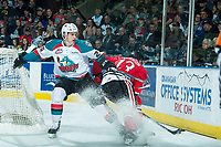 KELOWNA, CANADA - APRIL 8: Cal Foote #25 of the Kelowna Rockets checks Keegan Iverson #13 of the Portland Winterhawks behind the net in second period on April 8, 2017 at Prospera Place in Kelowna, British Columbia, Canada.  (Photo by Marissa Baecker/Shoot the Breeze)  *** Local Caption ***