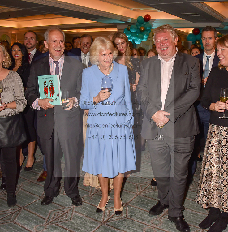 Gyles Brandreth, HRH The Duchess of Cornwall and Nick Ferrari at the launch of the Fortnum & Mason Christmas & Other Winter Feasts Cook Book by Tom Parker Bowles held at Fortnum & Mason, 181 Piccadilly, London, England. 17 October 2018.