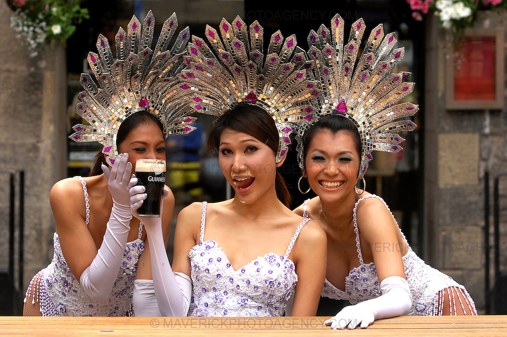 The Lady Boys of Bangkok return to Edinburgh for their eleventh successive Fringe season with their new Homecoming 2009 show, The Mile High Tour...This year the performance is sponsored by Festival Inns who will be running special Lady Boys of Bangkok promotions at their 20 hotels, bars and clubs in the city...Picture shows a Lady Boy trying a pint of Guiness for the first time at the three sisters pub in the Cowgate.