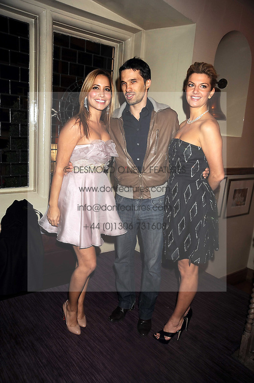 Left to right, DAYA FERNANDEZ, OLIVIER MARTINEZ and INGE THERON at a party to celebrate the launch of Hollywood Domino - a brand new board game, held at Mosimann's 11b West Halkin Street, London on 7th November 2008.  The evening was in aid of Charlize Theron's Africa Outreach Project.