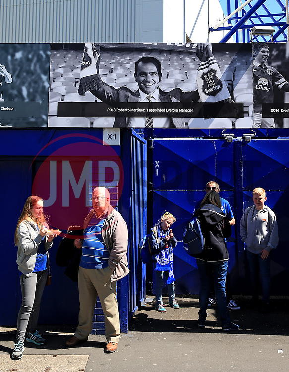 Fans stand beside a Roberto Martinez banner outside Goodison Park - Mandatory byline: Matt McNulty/JMP - 15/05/2016 - FOOTBALL - Goodison Park - Liverpool, England - Everton v Norwich City - Barclays Premier League