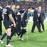 Aaron Cruden, New Zealand on crutches as Dan Carter talks to Sonny Bill Williams during the New Zealand V France Final at the IRB Rugby World Cup tournament, Eden Park, Auckland, New Zealand. 23rd October 2011. Photo Tim Clayton...