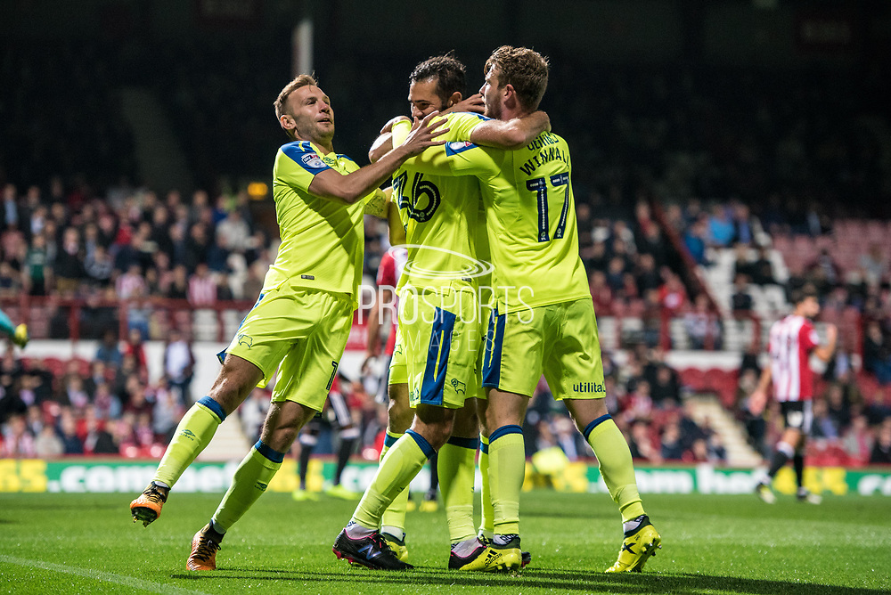 Derby County (36) Joe Ledley, Derby County (17) Sam Winnall, celebrate goal  during the EFL Sky Bet Championship match between Brentford and Derby County at Griffin Park, London, England on 26 September 2017. Photo by Sebastian Frej.
