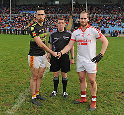 Captains Rory Byrne and Danny Geraghty with ref Declan Corcoran before the County Senior final at McHale park on sunday last.<br /> Pic Conor Mckeown