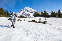 A woman hiking in Spray Park, Mount Rainier National Park, Washington, USA.