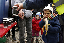 A migrant child eats a banana as hot drinks are distributed moments after the arrival of a rubber dinghy packed with refugees and migrants on a beach on the Greek island of Lesbos, January 29, 2016. REUTERS/Darrin Zammit Lupi MALTA OUT. NO COMMERCIAL OR EDITORIAL SALES IN MALTA      TPX IMAGES OF THE DAY      - RTX24LAL