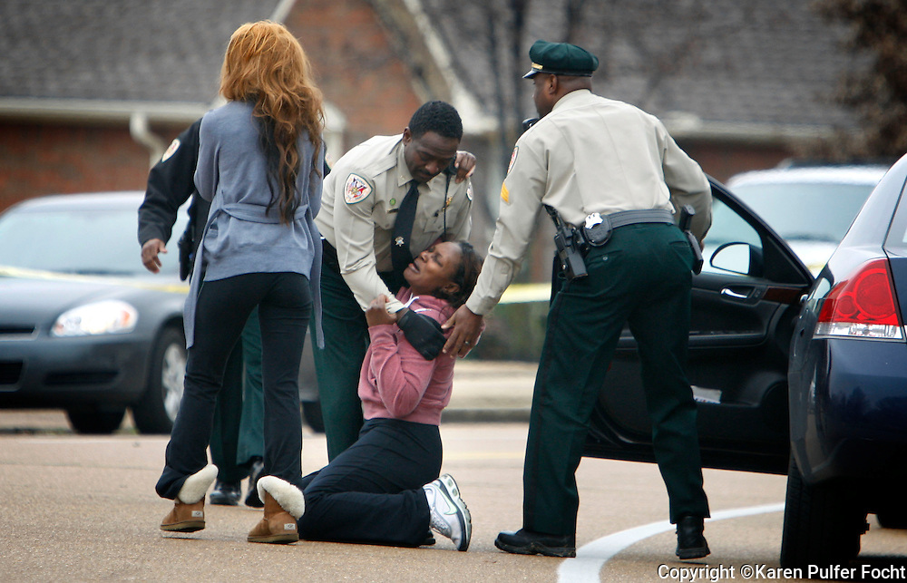 February 21, 2013 -  Officers with the Shelby County Sheriffs department catch a woman, who screamed and then collapsed, shortly after she arrived on the scene of possible murder in Cordova. The victim, who had not been seen for a couple of days, was a relative of hers. Police were called to the house, where a man's body was found. The home was near  Portside and Cordova Club Drive. Officers were called to check on the welfare of the victim, when they arrived, they found the body of a man who appeared to be in his 40's and they began to investigate as a possible murder.  (Karen Pulfer Focht/  The Commercial Appeal)