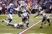 Indianapolis Colts wide receiver Donte Moncrief (10) tries to elude tackle attempts by New York Jets cornerback Darrelle Revis (24), leaping New York Jets defensive back Buster Skrine (41), and New York Jets free safety Jaiquawn Jarrett (37) as he catches a third quarter pass for a gain of 15 yards during the 2015 NFL week 2 regular season football game against the New York Jets on Monday, Sept. 21, 2015 in Indianapolis. The Jets won the game 20-7. (©Paul Anthony Spinelli)