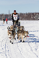 Musher Allen Moore after the restart in Willow of the 46th Iditarod Trail Sled Dog Race in Southcentral Alaska.  Afternoon. Winter.