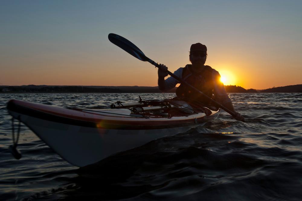 Sea kayakers at sunset on Lake Superior.