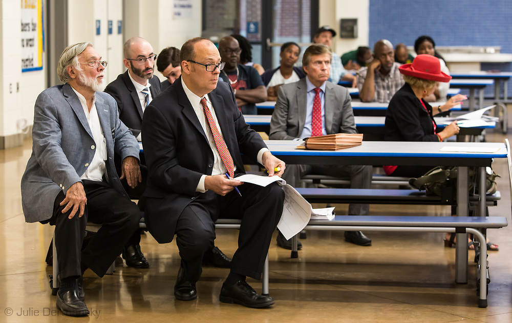 Attorneys John Cummings and Eberhard D. Garrison at a school board town hall meeting in LaPlace, Louisiana.