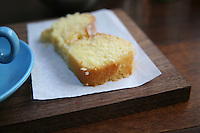lemon drizzle cake with blue cup and saucer