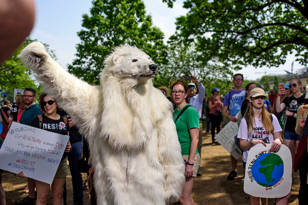 Washington, D.C. - April 29, 2017: Bill Snape dresses as Frostpaw the polar bear during the People's Climate Movement in Washington D.C. Saturday April 29, 2017. <br /> <br /> <br /> The League of Conservation Voters and Chispa participate in the People's Climate Movement in Washington D.C. Saturday April 29, 2017. <br /> <br /> <br /> CREDIT: Matt Roth for The League of Conservation Voters