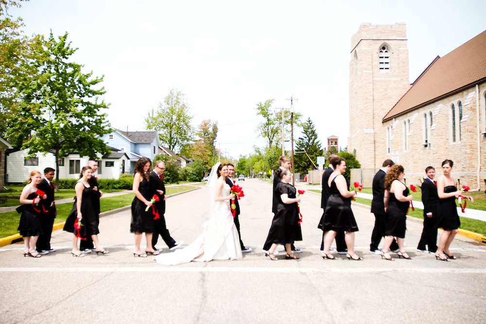 Peyton & Betsy's bridal party imitates the Beatles Abbey Road album cover, in front of St. Paul's Lutheran Church, Steven's Point, WI